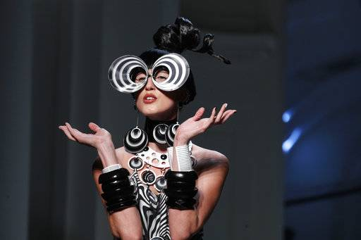 A model wears a creation for the Jean Paul Gaultier Haute Couture Spring-Summer 2018 fashion collection presented in Paris, Wednesday, Jan. 24, 2018. (AP Photo/Francois Mori)
