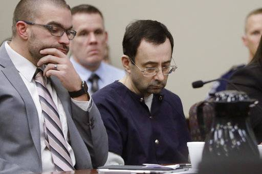 "Larry Nassar sits with attorney Matt Newburg during his sentencing hearing Wednesday, Jan. 24, 2018, in Lansing, Mich. The former sports doctor who admitted molesting some of the nation's top gymnasts for years was sentenced Wednesday to 40 to 175 years in prison as the judge declared: ""I just signed your death warrant."" The sentence capped a remarkable seven-day hearing in which scores of Nassar's victims were able to confront him face to face in the Michigan courtroom. (AP Photo/Carlos Osorio)"