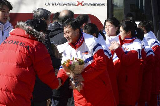 The North Korean women's ice hockey players are greeted as they arrive at the South Korea's national training center, Thursday, Jan. 25, 2018, in Jincheon, South Korea. Twelve North Korean female hockey players have crossed the border into South Korea to form the rivals' first-ever Olympic team during next month's Pyeongchang Winter Games. (Song Kyung-Seok/Pool Photo via AP)