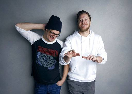 "Director Don Argott, left, and Dan Reynolds pose for a portrait to promote the film, ""Believer"", at the Music Lodge during the Sundance Film Festival on Sunday, Jan. 21, 2018, in Park City, Utah. The Mormon frontman of the Imagine Dragons rock band hopes the Sundance Film Festival documentary that follows his journey to becoming an advocate for LGBT Mormon youth triggers real change by his religion's leaders and puts an end to what he calls shaming of gay and lesbian kids in the religion. (Photo by Taylor Jewell/Invision/AP)"