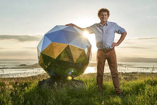 "In this Nov. 2017 photo provided by Rocket Lab, Rocket Lab founder and CEO Peter Beck is pictured with his ""Humanity Star"" in Auckland, New Zealand. Beck, the founder of the company that this week launched the first rocket into orbit from New Zealand said on Wednesday, Jan 24, 2018, that he had deployed a secret satellite he believes will be the brightest object in the night sky and which he hopes will remind people of their precarious place in a vast universe. (Rocket Lab via AP)"
