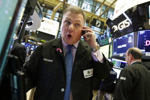 Trader George Ettinger works on the floor of the New York Stock Exchange, Wednesday, Jan. 24, 2018. Health care and consumer-focused companies are rising in early trading as stocks look to extend their winning streak to a fourth day. (AP Photo/Richard Drew)