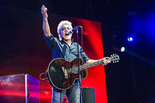 "FILE - In this July 13, 2017, file photo, Roger Daltrey of The Who performs during the Festival d'ete de Quebec in Quebec City, Canada. The summer home of the Boston Symphony Orchestra announced Wednesday, Jan. 24, 2018, that Daltrey and the Boston Pops will open the season June 15 with a performance of The Who's iconic rock opera ""Tommy.� It will be Daltrey's first performance at the venue since 1970. (Photo by Amy Harris/Invision/AP, File)"