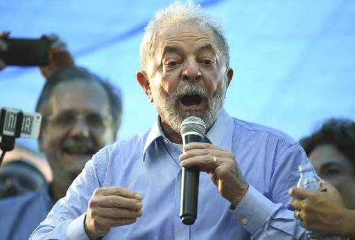 Former Brazilian President Luiz Inacio Lula da Silva speaks during a demonstration in his support in Porto Alegre, Brazil, Tuesday, Jan. 23, 2018. Brazilian judges are scheduled to rule Wednesday on da Silva's appeal of his conviction on corruption and money laundering charges. (AP Photo/Wesley Santos)