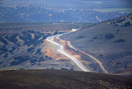 "A view of the Turkey-Syria border as seen from the Hatay province, Turkey, Wednesday, Jan. 24, 2018. Turkey's President Recep Tayyip Erdogan said Wednesday its military offensive into a Kurdish-held enclave in northern Syria is progressing ""successfully"" and will continue until the last ""terrorist is eliminated"". (AP Photo/Lefteris Pitarakis)"