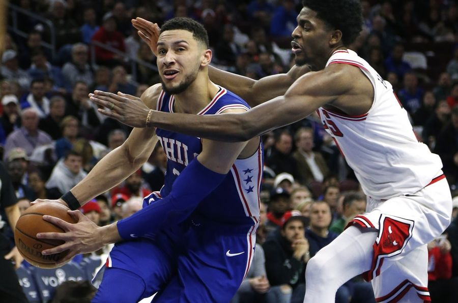 Philadelphia 76ers guard Ben Simmons (25), left, moves around Chicago Bulls guard Justin Holiday (7) during the second half on an NBA basketball game Wednesday, Jan. 24, 2018, in Philadelphia. The 76ers won 115-101.