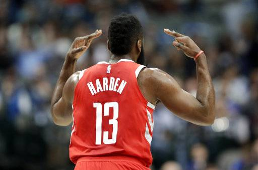 Houston Rockets guard James Harden (13) celebrates sinking a three-point basket in the first half of an NBA basketball game against the Dallas Mavericks on Wednesday, Jan. 24, 2018, in Dallas. (AP Photo/Tony Gutierrez)
