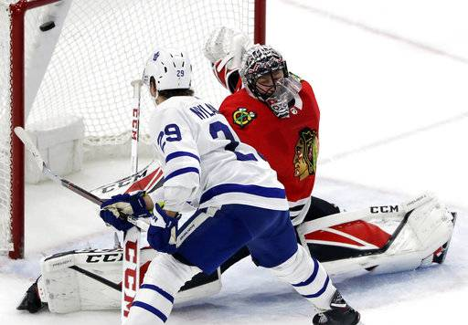 Toronto Maple Leafs center William Nylander (29) scores on a penalty shot against Chicago Blackhawks goalie Jeff Glass during the overtime period of an NHL hockey game Wednesday, Jan. 24, 2018, in Chicago. The Toronto Maple Leafs defeated the Chicago Blackhawks 3-2 in overtime. (AP Photo/Nam Y. Huh)