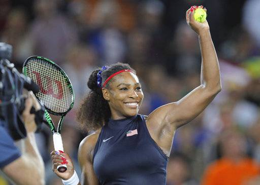 FILE - In this Aug. 8, 2016, file photo, Serena Williams, of the United States, prepares to hit an autographed ball into the crowd after defeating France's Alize Cornet in the women's tennis competition at the 2016 Summer Olympics in Rio de Janeiro, Brazil. Williams is returning to tournament play for the first time since the birth of her first child. Williams was among the entries released Wednesday, Jan. 24, 2018, for the BNP Paribas Open, which runs March 5-18, in Indian Wells, Calif. (AP Photo/Vadim Ghirda, File)