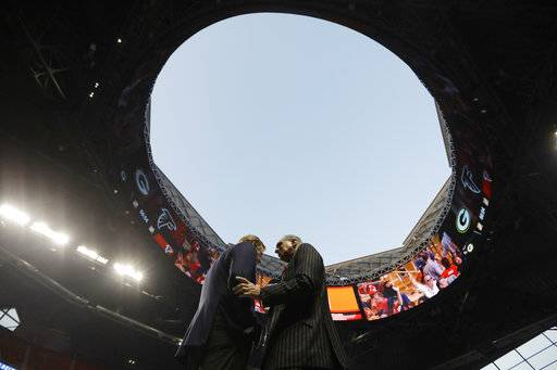 "FILE - In this Sept. 17, 2017, file photo, NFL Commissioner Roger Goodell, left, speaks with Atlanta Falcons owner Arthur Blank under the open roof, before an NFL football game between the Falcons and the Green Bay Packers in Atlanta. TheFalcons are expecting the retractable roof to be ""fully operational� for the 2018 season and next year's Super Bowl. Falcons president and CEO Rich McKay told The Associated Press on Wednesday, Jan. 24, 2018, he expects fixes on the roof by the 2018 season ""if not well before.� Problems kept the roof closed on the $1.5 billion stadium for most of the 2017 season. The unique roof, designed to open like a camera lens, was open only for the Falcons' first home regular-season game. (AP Photo/David Goldman, File)"