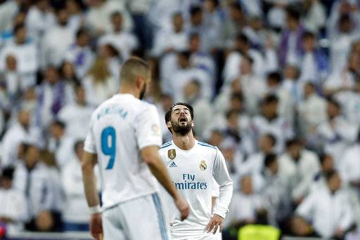 "Real Madrid's Francisco Roman ""Isco"" reacts fter Leganes scored a goal during of the Spanish Copa del Rey quarterfinal second leg soccer match between Real Madrid and Leganes at the Santiago Bernabeu stadium in Madrid, Wednesday, Jan. 24, 2018. Leganes won 2-1. (AP Photo/Francisco Seco)"