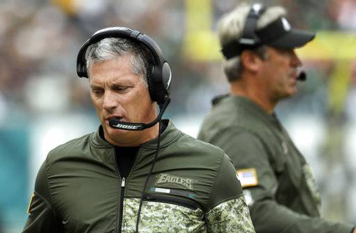FILE - In this Nov. 5, 2017, file photo, Philadelphia Eagles' Jim Schwartz watches from the sideline during the first half of an NFL football game against the Denver Broncos in Philadelphia. Schwartz doesn't appear to be getting a head coaching job but perhaps deserves one after the way he's rebuilt an awful defense in two years. The Eagles ranked among the bottom three for three straight years under Chip Kelly and rose to the top five under Schwartz.(AP Photo/Michael Perez, File)