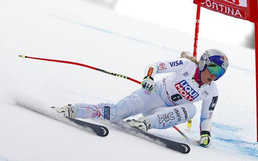 FILE - In this Sunday Jan. 21, 2018, file photo, United States' Lindsey Vonn speeds down the course during the women's World Cup super-G ski race in Cortina D'Ampezzo, Italy. Past Olympic gold medalists Lindsey Vonn, Mikaela Shiffrin, Ted Ligety and Andrew Weibrecht are among the 22 ski racers named to the U.S. Alpine team heading to the Pyeongchang Games. (AP Photo/Gabriele Facciotti, File)