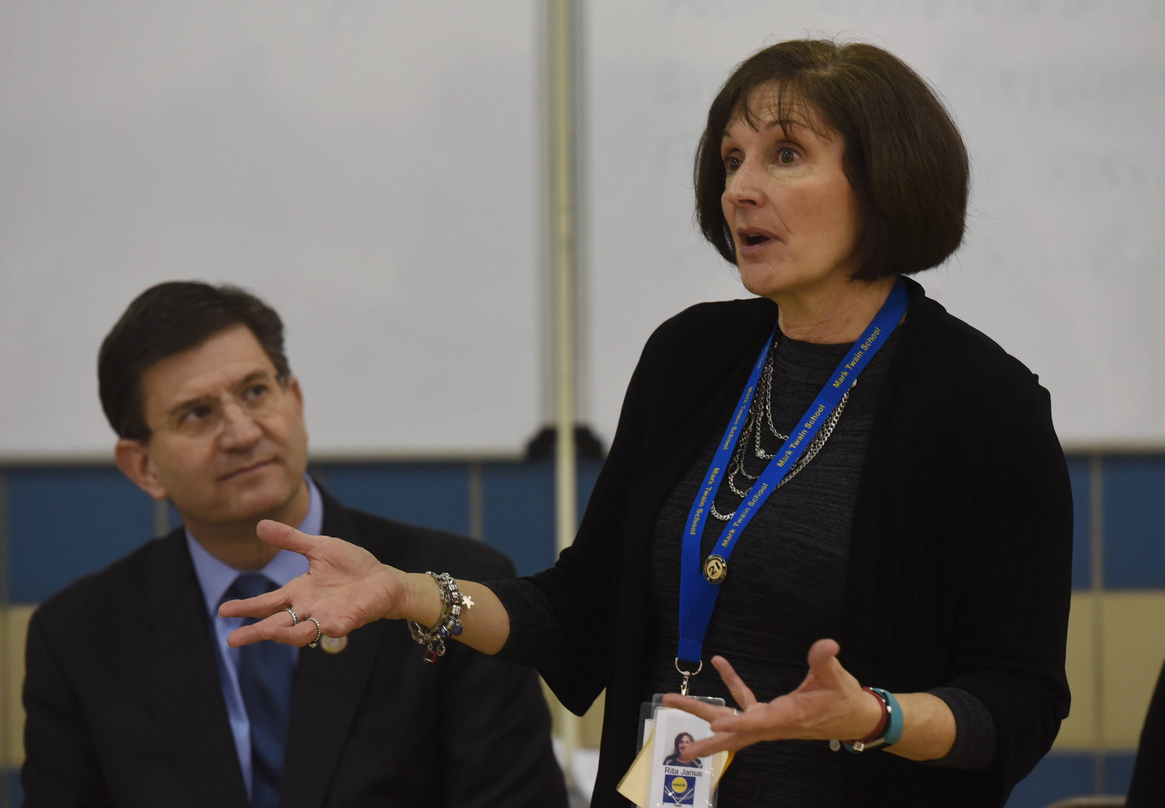 With Rep. Brad Schneider seated behind her, Principal Rita Janus answers a question Thursday about the Breakfast After the Bell program at Mark Twain Elementary School in Wheeling.