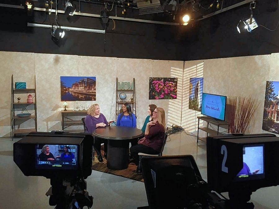 """Naperville Moms Network"" talk show contributors Patti Minglin, Saritha Arellano and Erika Lopez chat with host Cathy Subber on set as they film the first episode, which is set to air at 9 p.m. Thursday, Feb. 1, on NCTV-17."