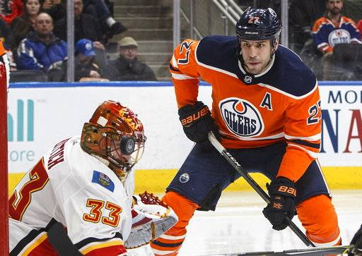 f977dc84a Calgary Flames goaltender David Rittich (33) makes a stop with his mask as  Edmonton