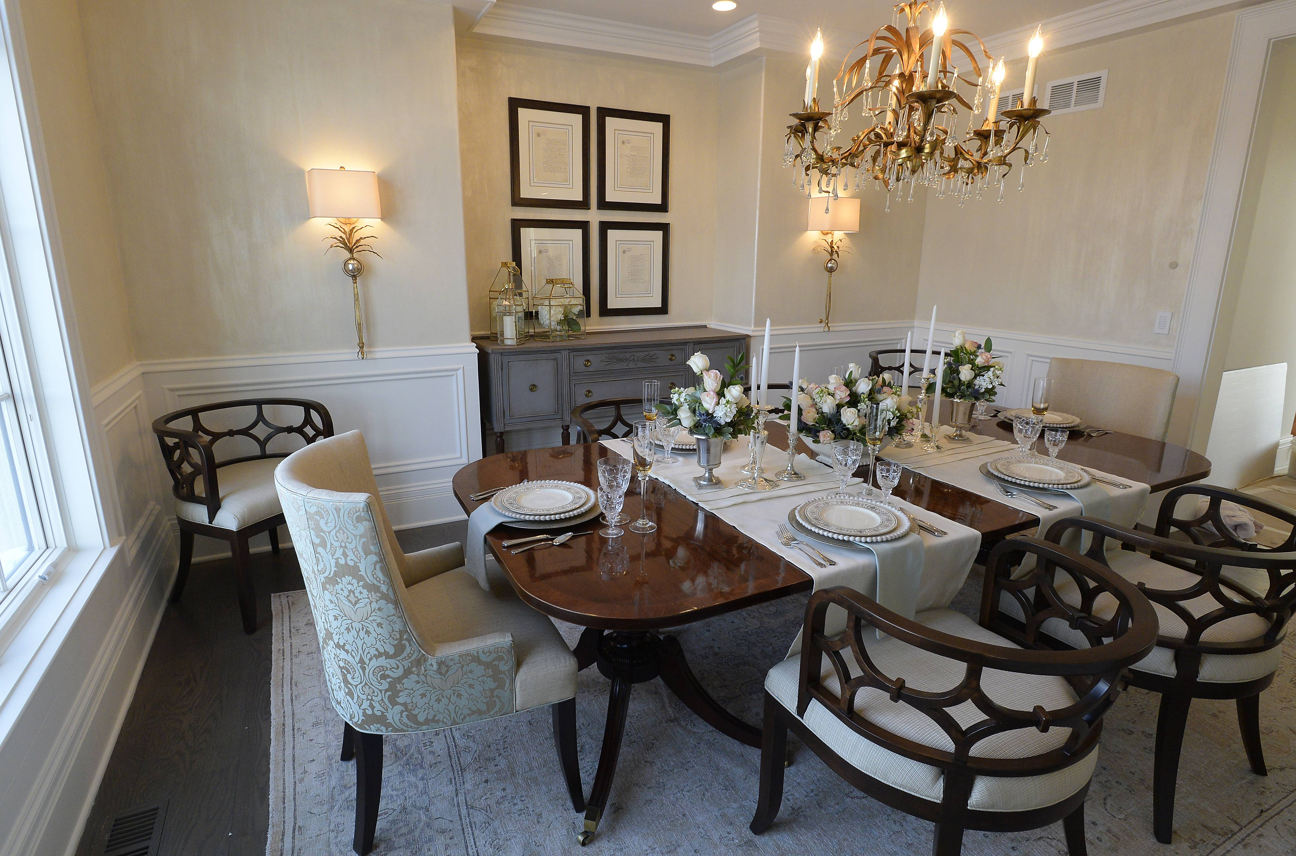 Meredith Park, owner of an Inverness interior design firm, designed the home's dining room using a mixture of traditional and transitional styles, including a vintage table and buffet that outgassed years ago and is now safe.