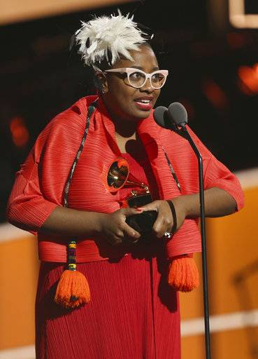 "Cecile McLorin Salvant accepts the best jazz vocal album award for ""Dreams And Daggers"" at the 60th annual Grammy Awards at Madison Square Garden on Sunday, Jan. 28, 2018, in New York. (Photo by Matt Sayles/Invision/AP)"