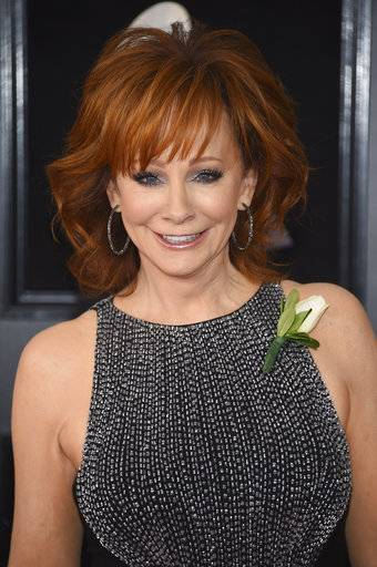 Reba McEntire arrives at the 60th annual Grammy Awards at Madison Square Garden on Sunday, Jan. 28, 2018, in New York. (Photo by Evan Agostini/Invision/AP)