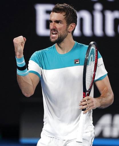 Croatia's Marin Cilic reacts after winning a point against Switzerland's Roger Federer during the men's singles final at the Australian Open tennis championships in Melbourne, Australia, Sunday, Jan. 28, 2018.