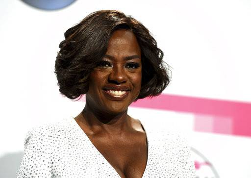 "FILE - In this Nov. 19, 2017 file photo, actress Viola Davis poses in the press room at the American Music Awards in Los Angeles. Davis Davis produced and narrates the documentary series ""Two Sides,� airing on TV One. (Photo by Jordan Strauss/Invision/AP, File)"