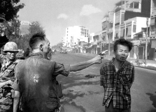 FILE - In this Feb. 1, 1968, file photo, South Vietnamese Gen. Nguyen Ngoc Loan, chief of the National Police, fires his pistol into the head of suspected Viet Cong officer Nguyen Van Lem (also known as Bay Lop) on a Saigon street, early in the Tet Offensive. The photo showed the war's brutality in a way Americans hadn't seen before. Protesters saw it as graphic evidence that the U.S. was fighting on the side of an unjust government.