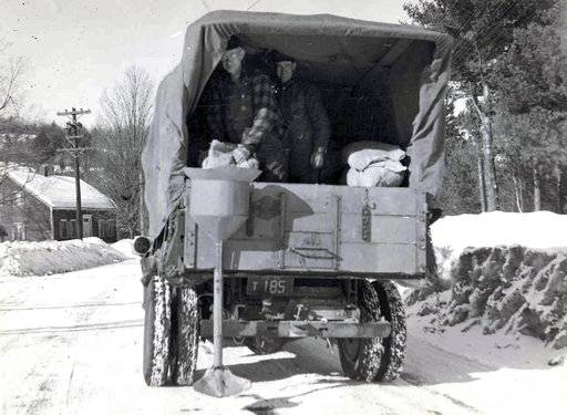 This circa 1940s photo released by the New Hampshire Department of Transportation archives shows salt being applied for anti-icing on a New Hampshire roadway. Some 20 million tons of salt is dispersed every year on American roads. Scientists in 2018 are starting to raise concerns about road salt's impact on the environment, especially drinking water, because lakes and streams near roads are showing elevated levels of sodium and chloride. (New Hampshire Department of Transportation via AP)