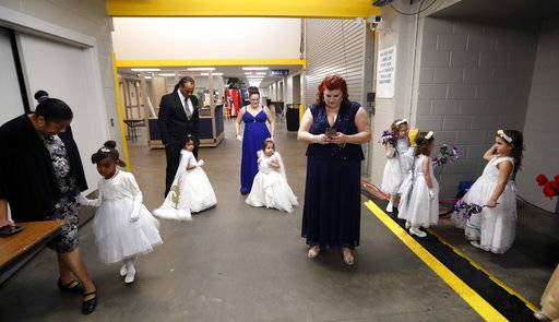 Children in the royal court wait back stage with their parents before the start of the Little Rascals Mardi Gras Ball in Kenner, La., Thursday, Jan. 25, 2018. The more than 200 kids riding in Sunday's parade participated in a glitzy ball held in their honor.