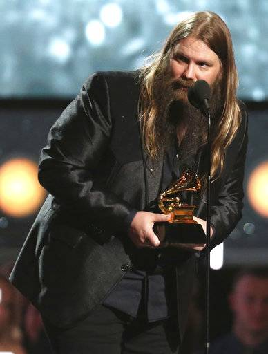 "Chris Stapleton accepts the award for best country album for ""From A Room: Volume 1"" at the 60th annual Grammy Awards at Madison Square Garden on Sunday, Jan. 28, 2018, in New York. (Photo by Matt Sayles/Invision/AP)"