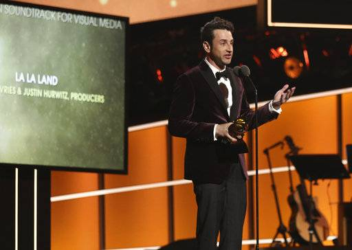 "Justin Hurwitz accepts the best compilation soundtrack for visual media award for ""La La Land"" at the 60th annual Grammy Awards at Madison Square Garden on Sunday, Jan. 28, 2018, in New York. (Photo by Matt Sayles/Invision/AP)"