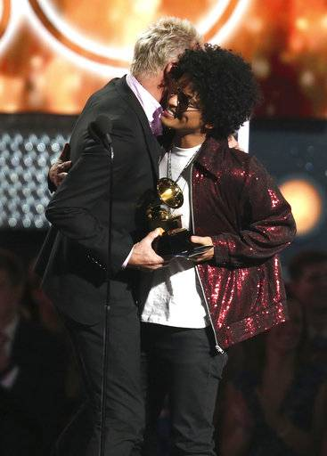 "Sting, left, embraces Bruno Mars as he presents Mars with the award for song of the year for ""That's What I Like"" at the 60th annual Grammy Awards at Madison Square Garden on Sunday, Jan. 28, 2018, in New York. (Photo by Matt Sayles/Invision/AP)"