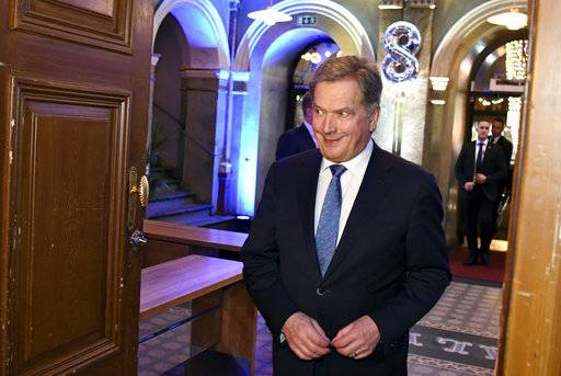 The independent presidential candidate Sauli Niinisto arrives at his election reception in Helsinki, Finland, Sunday, Jan. 28, 2018.  Finns were casting ballots in a presidential election, with incumbent Sauli Niinisto considered the favorite to win the first round of voting in the Nordic nation. (Jussi Nukari/Lehtikuva via AP)