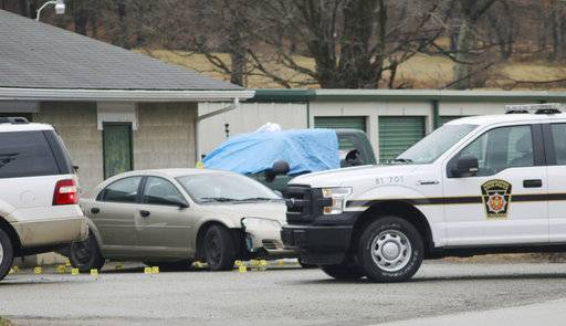 Evidence markers sit on the scene of a fatal shooting at a car wash in Melcroft, Pa., Sunday, Jan. 28, 2018. (Michael Palm /Herald-Standard via AP)