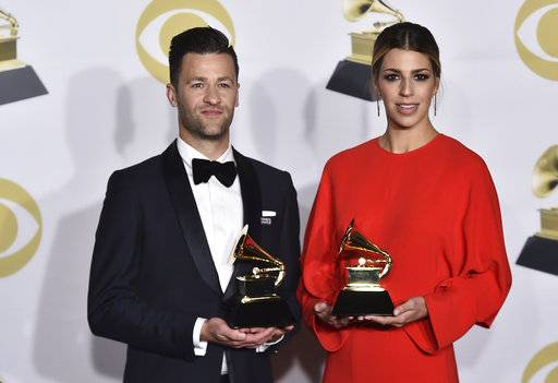 "Ben Fielding, left, and Brooke Ligertwood, of Hillsong Worship, pose in the press room with the best contemporary Christian music performance/song award for ""What A Beautiful Name"" at the 60th annual Grammy Awards at Madison Square Garden on Sunday, Jan. 28, 2018, in New York. (Photo by Charles Sykes/Invision/AP)"