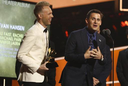 "Benj Pasek, right, and Justin Paul accept the best musical theater album award for ""Dear Evan Hansen"" at the 60th annual Grammy Awards at Madison Square Garden on Sunday, Jan. 28, 2018, in New York. (Photo by Matt Sayles/Invision/AP)"