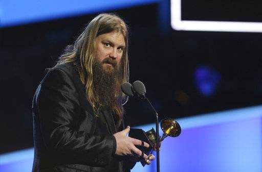 "Chris Stapleton accepts the best country solo performance award for ""Either Way"" at the 60th annual Grammy Awards at Madison Square Garden on Sunday, Jan. 28, 2018, in New York. (Photo by Matt Sayles/Invision/AP)"