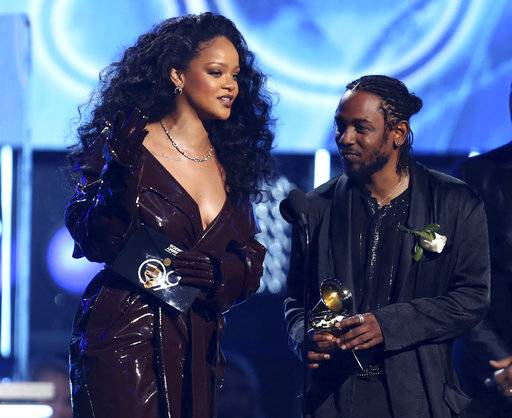 "Rihanna, left, and Kendrick Lamar accept the award for best rap/sung performance for ""Loyalty."" at the 60th annual Grammy Awards at Madison Square Garden on Sunday, Jan. 28, 2018, in New York. (Photo by Matt Sayles/Invision/AP)"