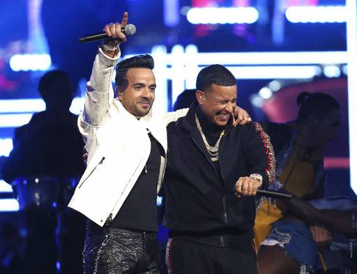 "Luis Fonsi, left, and Daddy Yankee perform ""Despacito"" at the 60th annual Grammy Awards at Madison Square Garden on Sunday, Jan. 28, 2018, in New York. (Photo by Matt Sayles/Invision/AP)"