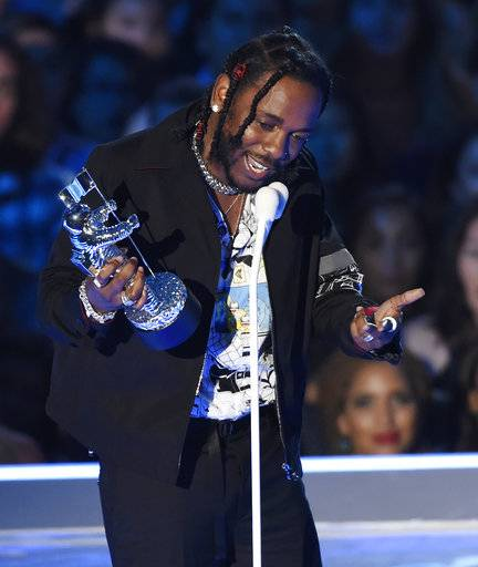 "FILE - In this Sunday, Aug. 27, 2017 file photo, Kendrick Lamar accepts the award for video of the year for ""HUMBLE."" at the MTV Video Music Awards at The Forum in Inglewood, Calif. Four of the five album of the year nominees at the 2018 Grammys are rap and R&B-based albums from black or Latino artists, including Lamar. (Photo by Chris Pizzello/Invision/AP)"