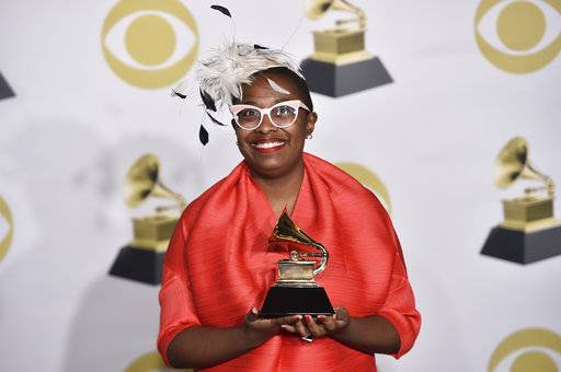 "Cecile McLorin Salvant poses in the press room with the best jazz vocal album award for ""Dreams And Daggers"" at the 60th annual Grammy Awards at Madison Square Garden on Sunday, Jan. 28, 2018, in New York. (Photo by Charles Sykes/Invision/AP)"