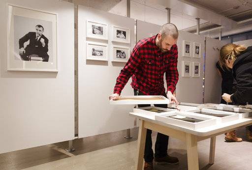 Employees prepare pictures for a diplay featuring the founder of Swedish multinational furniture retailer IKEA, Ingvar Kamprad, at the IKEA museum, in Almhult, Sweden, on Sunday Jan. 28, 2018. Kamprad died Saturday Jan. 27, aged 91.  (Ola Torkelsson/TT via AP)