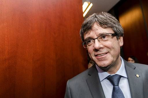 Ousted Catalan leader Carles Puigdemont arrives to address the media after a meeting with the President of the Parliament of Catalonia Roger Torrent in Brussels on Wednesday, Jan. 24, 2018.