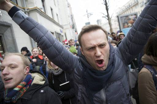 Russian opposition leader Alexei Navalny, centre, shouts slogans as he attends a rally in Moscow, Russia, Sunday, Jan. 28, 2018. Navalny has been arrested in Moscow as protests take place across the country.