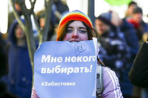 "A demonstrator holds a poster which reads ""I have no one to choose!! Strike."" during a rally in Vladivostok, Russia, Sunday, Jan. 28, 2018. Russian opposition politician Alexey Navalny calls for nationwide protests following Russia's Central Election Commission's decision to ban his presidential candidacy."