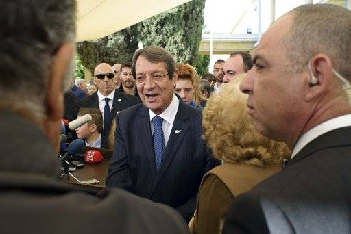 Cyprus' President and Cypriot Presidential candidate Nicos Anastasiades waves to the crowd outside a polling station during the presidential elections in the southern coastal city of Limassol, Cyprus, on Sunday, Jan. 28, 2018. Cypriots were voting Sunday for a new president who they hope will overcome years of failure and finally resolve the ethnic divisions that have torn the Mediterranean island-nation into a Greek south and a Turkish north.