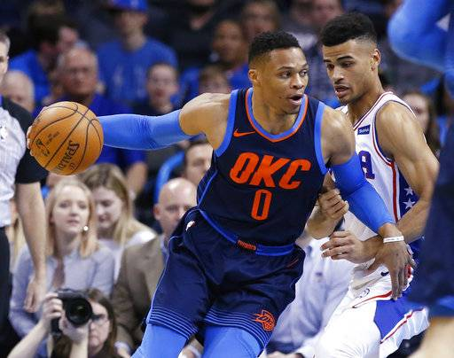Oklahoma City Thunder guard Russell Westbrook (0) drives around Philadelphia 76ers guard Timothe Luwawu-Cabarrot, right, in the first half of an NBA basketball game in Oklahoma City, Sunday, Jan. 28, 2018.
