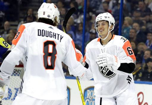 Pacific Division's Rickard Rakell, right, of the Anaheim Ducks, is congratulated by Drew Doughty, of the Los Angeles Kings, after scoring during the NHL hockey All-Star game with the Atlantic Division Sunday, Jan. 28, 2018 in Tampa, Fla.