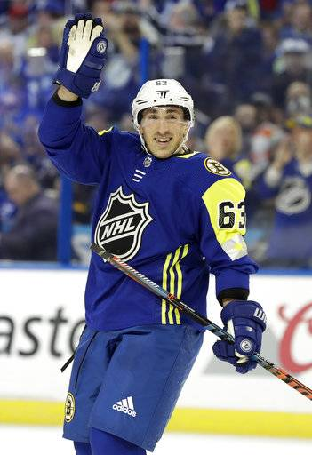 Atlantic Division's Brad Marchand, of the Boston Bruins, waves during the NHL hockey All-Star game with the Metropolitan Division Sunday, Jan. 28, 2018 in Tampa, Fla.