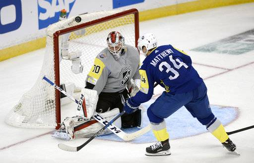 Atlantic Division's Auston Matthews (34), of the Toronto Maple Leafs, is unable to score past Metropolitan Division goalie Braden Holtby, of the Washington Capitals, during the NHL hockey All-Star game Sunday, Jan. 28, 2018 in Tampa, Fla.