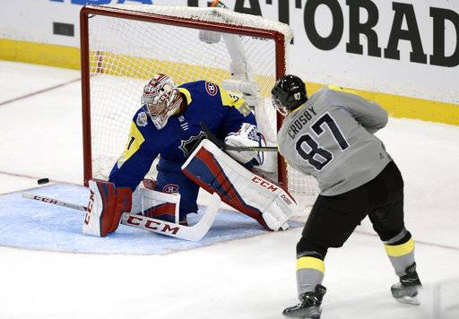 Metropolitan Division's Sidney Crosby (87), of the Pittsburgh Penguins, shoots wide of Atlantic Division goalie Carey Price, of Montreal Canadiens, during the NHL hockey All-Star game Sunday, Jan. 28, 2018 in Tampa, Fla.